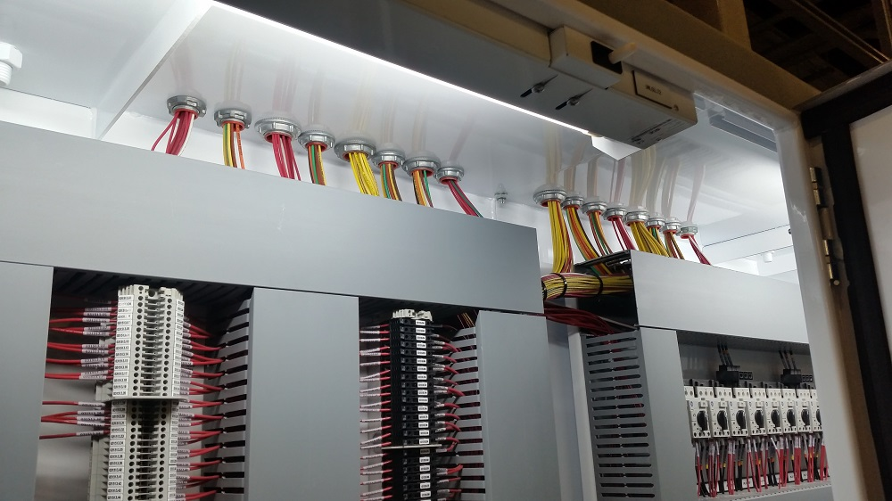 A completed Motor Control Panel after conduit installation, wire pull, and terminations.